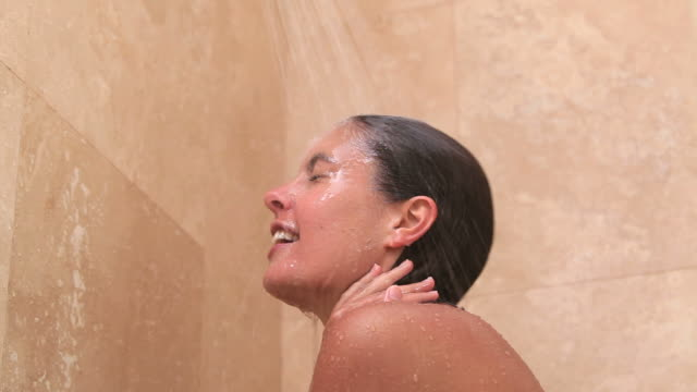 Naked woman taking a shower