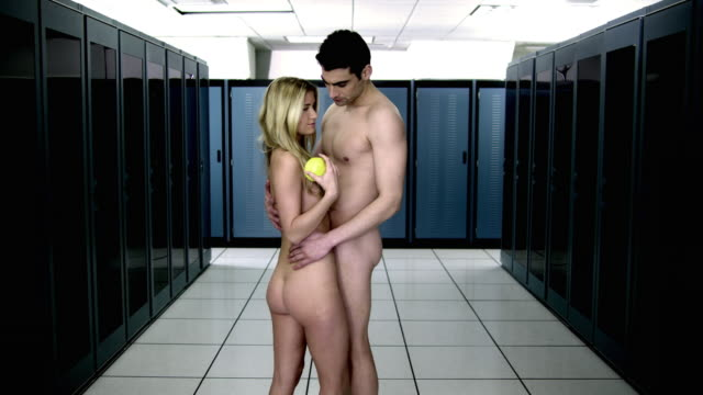 ws ds cu naked young couple embracing and kissing in server room, woman giving apple to man - fidanzata video stock e b–roll