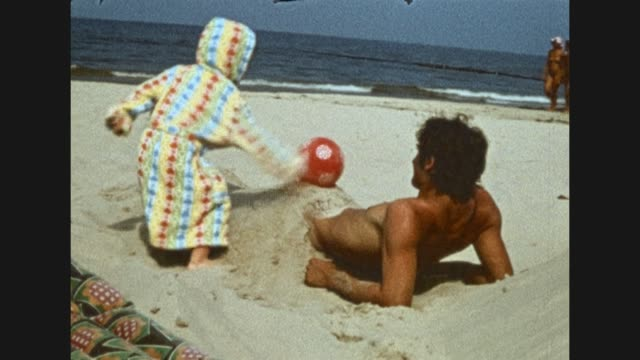 naked young man swimming in the baltic sea/ flying a kite in the water / young naked man playing with sand at the beach / boy kicks ball from the... - fkk stock-videos und b-roll-filmmaterial