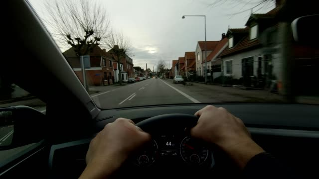 nakskov denmark pov person vehicle day driving steering car dashboard - land vehicle stock videos & royalty-free footage