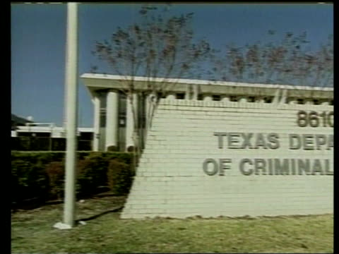 name on wall texas department of criminal justice pan to courtroom behind lgv court