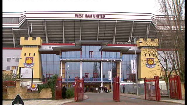 ext name 'west ham united' on stadium entrance pull out to gv vox pops west ham fans sot - west ham fc stock-videos und b-roll-filmmaterial