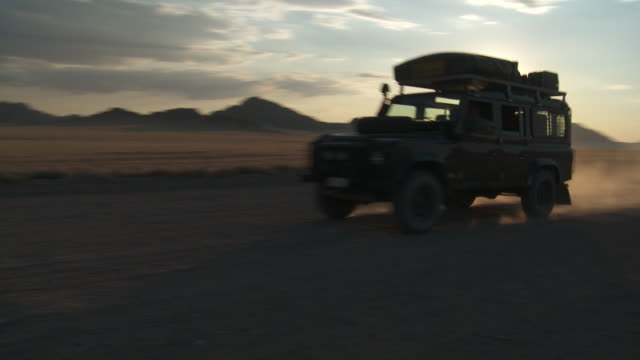 namib desert, road through plains - safari vehicle driving - 4x4 stock videos & royalty-free footage