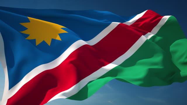 4k namibia flag - loopable - namibia stock videos & royalty-free footage