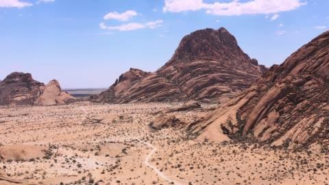 namibia spitzkoppe mountain peak spitzkuppe drone 4k video africa - dramatic landscape stock videos & royalty-free footage