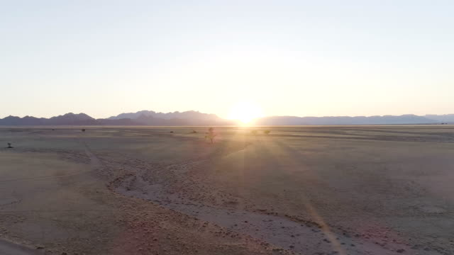namibian desert during sunset. aerial view - namibian desert stock videos and b-roll footage