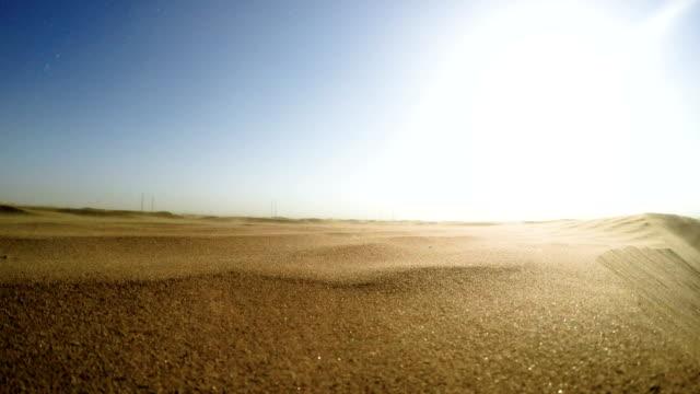 namibian desert. sun shining above sand dunes - namibian desert stock videos and b-roll footage