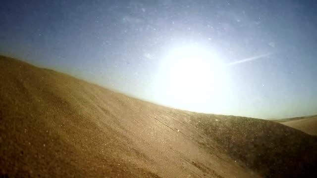 namibian desert. sun shining above sand dunes - eroded stock videos & royalty-free footage
