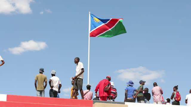 namibian flag waves during the celebration of the 29th anniversary of liberation of the country, at the independence stadium, in windhoek, namibia,... - 映像技法点の映像素材/bロール