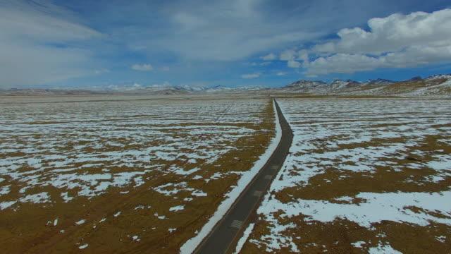 namtso lake,tibet landscape, tibet, china. - mountain road stock videos & royalty-free footage