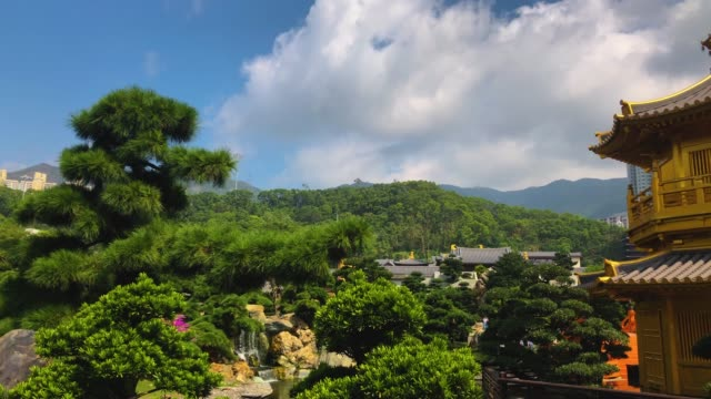 stockvideo's en b-roll-footage met nan lian tempel met hoog gebouw achtergrond - hong kong