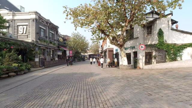 nanchang street, wuxi qingming bridge ancient canal scenic area, - jiangsu province stock videos & royalty-free footage