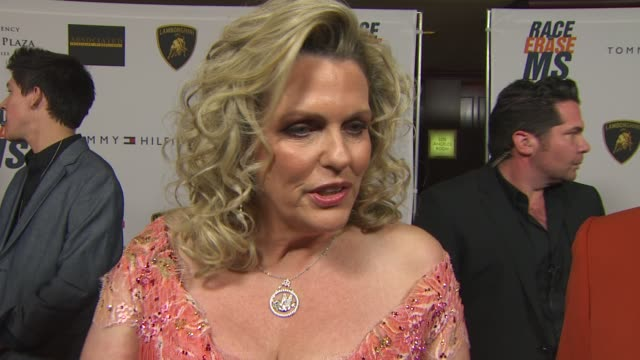 nancy davis & husband ken rickel on what the evening represents for the them, what makes this year different than any other at the 17th annual race... - ナンシー デイヴィス点の映像素材/bロール