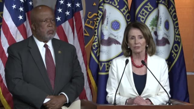 nancy house minority leader nancy pelosi of california enters the house studio for a weekly press briefing with mississippi congressman bennie... - nancy pelosi stock videos and b-roll footage