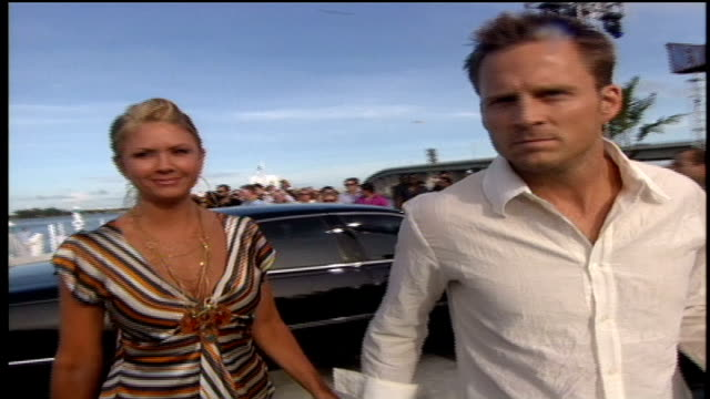 Nancy O'Dell and her husband Keith Zubchevich walking down the red carpet