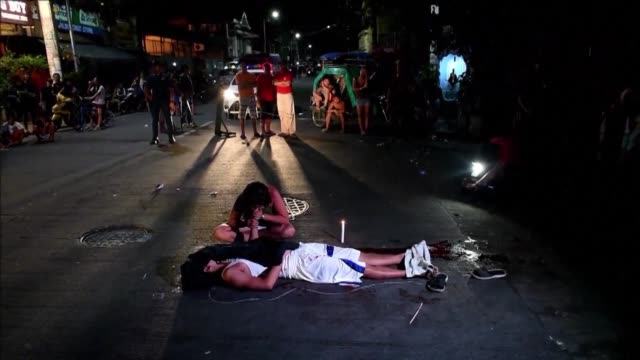 Nanette Castillo cries over the dead body of her son Aldrin an alleged drug user killed by unidentified assailants in Manila