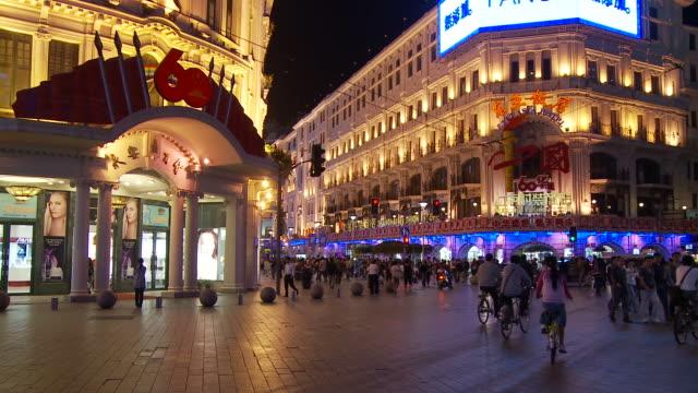 nanjing road at night in shanghai china - nanjing road stock videos & royalty-free footage