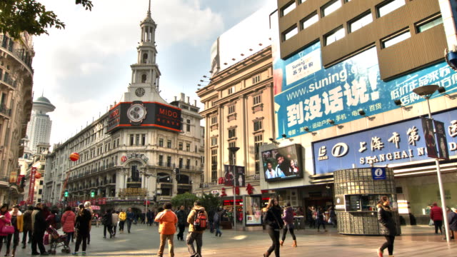 nanjing road, shanghai's most famous shopping street - nanjing road stock videos & royalty-free footage