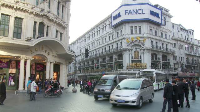 nanjing road traffic in shanghai china - nanjing road stock videos & royalty-free footage