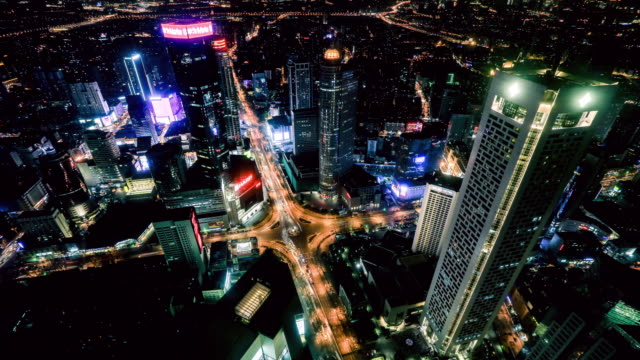 nanjing xinjiekou at night - nanjing stock-videos und b-roll-filmmaterial