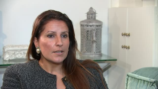 Nannies increasingly being banned from using social media while they're working ENGLAND London INT Paola Diana setup shot with reporter / interview...