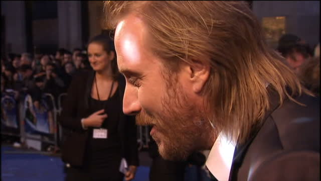 'nanny mcphee and the big bang' premiere at leicester square in london shows exterior shots of actor rhys ifans being interviewed on the red carpet - nanny stock videos & royalty-free footage