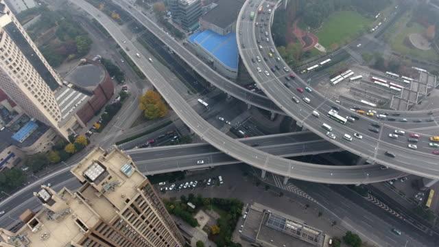 stockvideo's en b-roll-footage met nanpubrug brug luchtfoto highway kruispunt - dwarsweg
