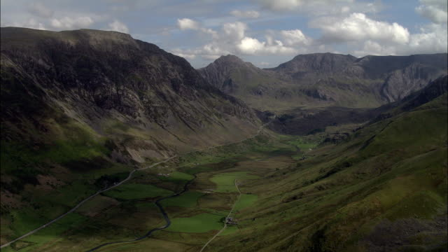 nant ffrancon valley  - aerial view - wales, caernarfonshire and merionethshire, united kingdom - crag stock videos and b-roll footage