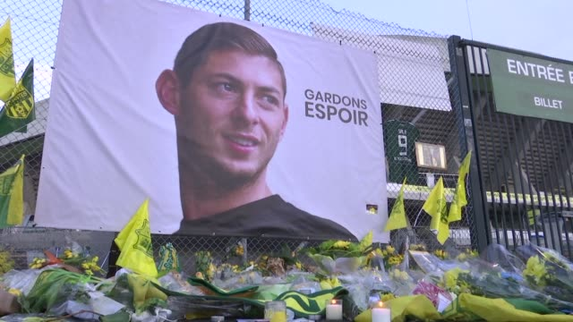 nantes fans gather and lay flowers in tribute to missing emiliano sala in front of club stadium before the ligue 1 match against saint etienne - nantes stock videos & royalty-free footage