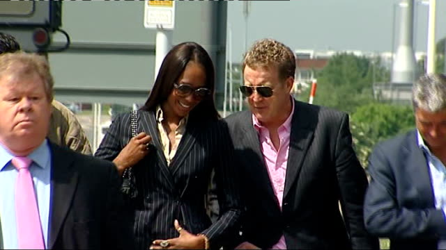 naomi campbell charged with assault england london heathrow airport police station ext naomi campbell arriving at police station with legal team - pinstripe stock videos & royalty-free footage