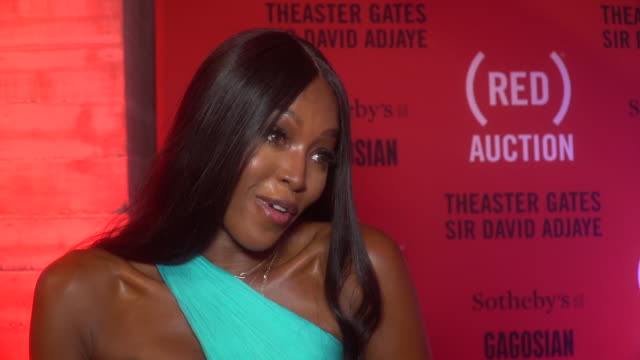 interview naomi campbell talks about the importance of these events at the auction with theaster gates sir david adjaye bono in collaboration with... - naomi campbell stock videos & royalty-free footage