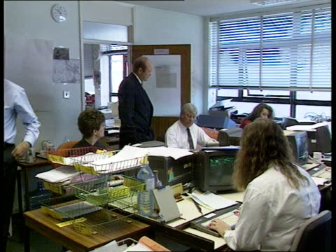 warwicks leekwootton cms tony bayliss and another into incident room pull out ditto and staff working at desks side woman working at vdu at desk tms... - computer monitor stock videos & royalty-free footage