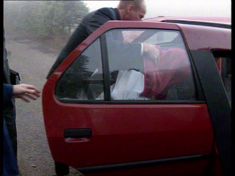 anat england warwickshire nuneaton convoy of range rover police van cars away track forward ms side range rover along track forward bv group of... - murder stock videos & royalty-free footage