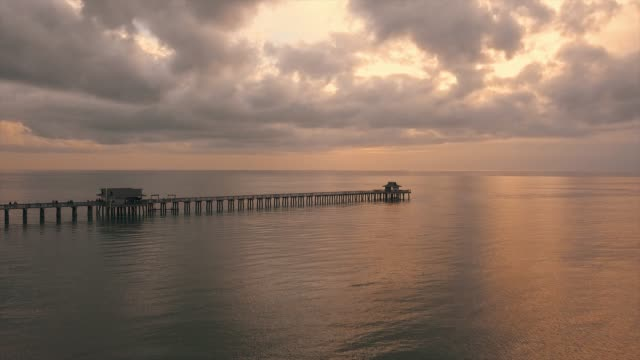 naples pier in florida at sunset - naples florida stock videos & royalty-free footage
