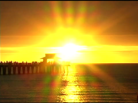 naples pier sunset timelapse (post method) 2 ntsc - naples florida stock videos & royalty-free footage
