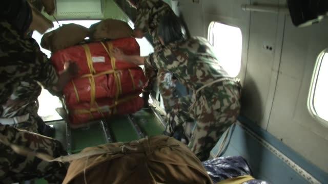 vídeos y material grabado en eventos de stock de napoli army prepare supplies for an air drop in plane over nepal / a major earthquake hit kathmandu midday on saturday april 25th and was followed by... - alivio