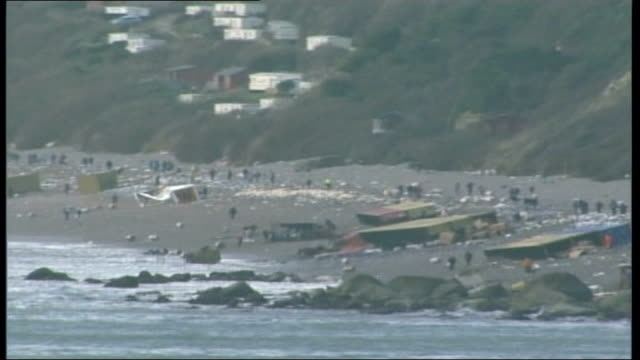 salvage operation tx air view of crowds of looters on branscombe beach birds covered in oil removed from cardboard box - itv weekend evening news stock-videos und b-roll-filmmaterial