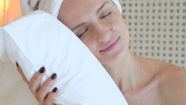 napping on a white pillow - wrapped in a towel stock videos & royalty-free footage
