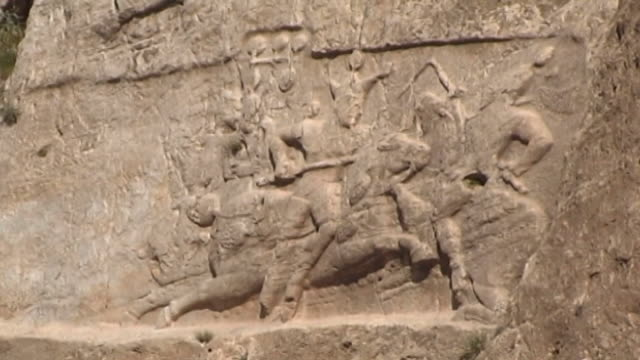 naqsh-e rustam. view of an equestrian relief of sasanian king bahram ii, at the necropolis of naqsh-e rustam in fars province. - felswand stock-videos und b-roll-filmmaterial