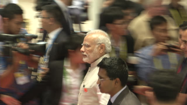 vídeos de stock, filmes e b-roll de narendra modi, prime minister of india, walks to a meeting during the association of southeast asian nations summit the laotian capital vientiane. - primeiro ministro