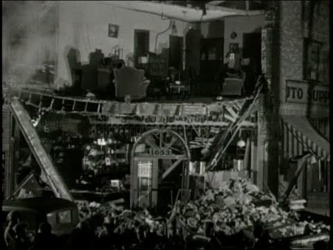 narrated / 1933 newsreel / residents of los angeles clean up after the earthquake / a 15 year old young man in los angeles / people outside in middle... - narrating stock videos and b-roll footage