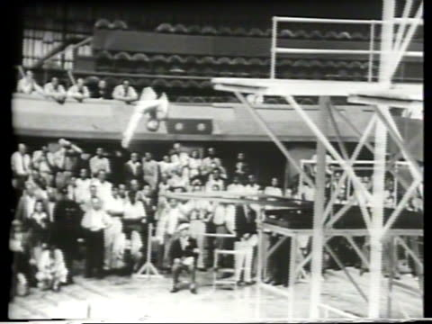Narrated / 1948 Newsreel / Olympic Swimming / Dr Sammy Lee on the diving board for the Men's 3M Diving Event and he takes third place / Miller...