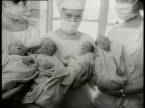 narrated / 1949 newsreel / a doctor counts bottles of milk for new quadruplets babies in the bronx / a door opens to reveal four nurses each holding... - narrating stock videos & royalty-free footage