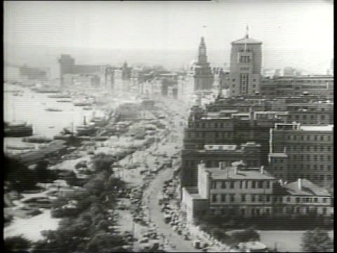 narrated / 1949 newsreel / cold war / americans urged to evacuate shanghai / us navy ships in port / people loading boats by stairs and ramps / 1930s... - stampeding stock videos & royalty-free footage