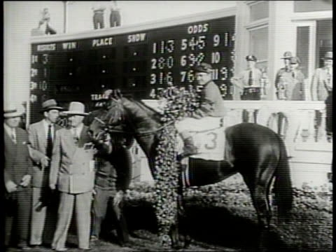 narrated / 1949 newsreel /crowd of people at kentucky derby / ponder heads to the winner circle of the 1949 kentucky derby with steve brooks as... - narrating stock videos & royalty-free footage