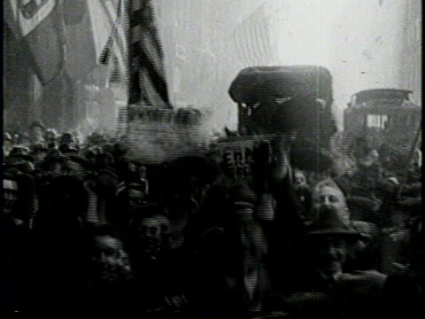 narrated / a graphic of an open book and credits / montage of crowded new york city streets women wearing costumes and wave flags / ship with bow... - armistice day stock videos and b-roll footage