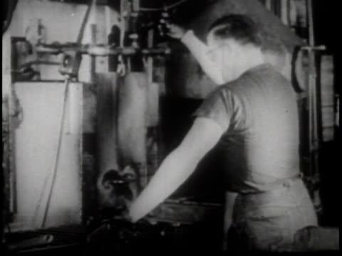 vídeos y material grabado en eventos de stock de narrated / a man runs a batch of pliers through factory machines / pliers being manufactured in a factory / - narrar