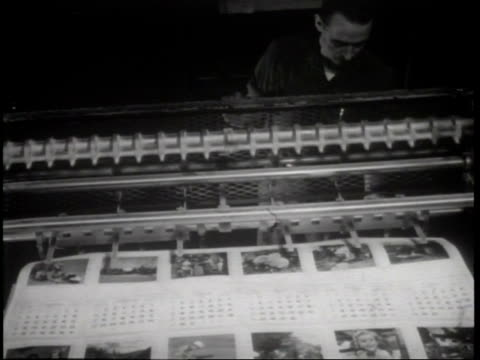 Narrated / A worker pulls uncut sheets of calendars off of the press / worker inspects one sheet as camera passes over it / Factory machines move...