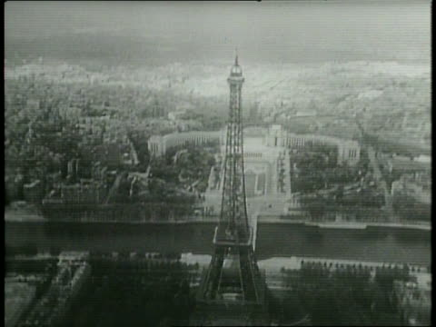 Narrated / Aerial view of the Eiffel Tower / The Palais Rose / Airplane arrives / Secretary of State Dean Acheson arrives in Paris by plane / US...