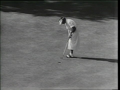 narrated / at a championship tournament at tam o'shanter golf course a lively audience watches the game / babe didrikson zaharias walks through the... - tam bildbanksvideor och videomaterial från bakom kulisserna